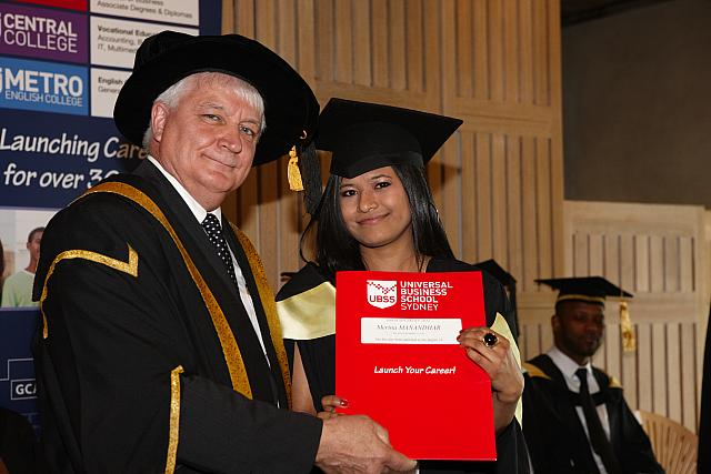 Merina Manandhar receiving their degree at the November 2012 UBSS Graduation, Opera House, Sydney Australia.