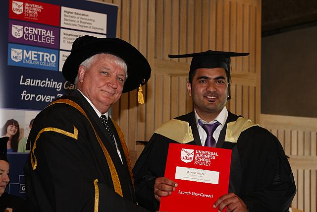 Ramesh Rimal receiving their degree at the November 2012 UBSS Graduation, Opera House, Sydney Australia.