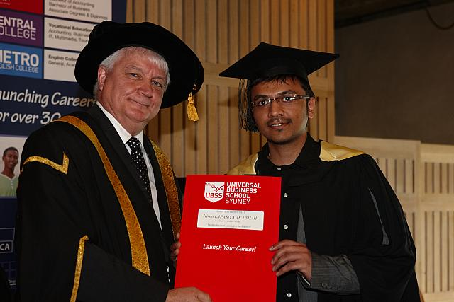 Hiren Shah receiving their degree at the November 2012 UBSS Graduation, Opera House, Sydney Australia.