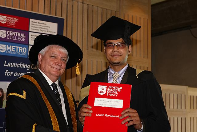Bachhu Shrestha receiving their degree at the November 2012 UBSS Graduation, Opera House, Sydney Australia.