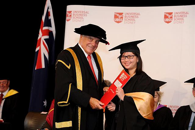 Meiry Waty receiving their degree at the April 2014 UBSS Graduation, Opera House, Sydney Australia.