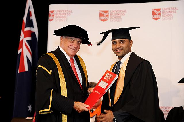 Dushyant Yadav receiving their degree at the April 2014 UBSS Graduation, Opera House, Sydney Australia.
