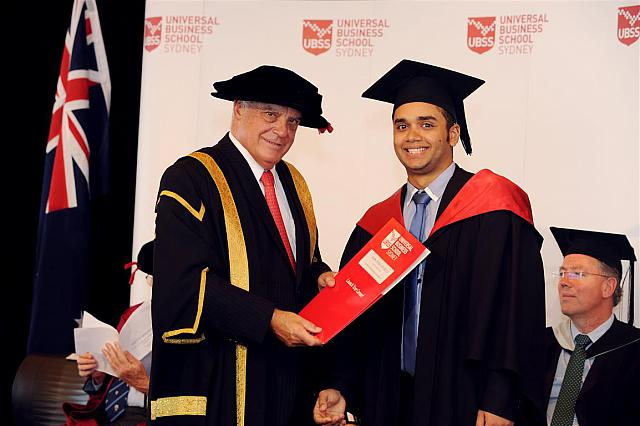 Andre Felipe Da Silva receiving their degree at the April 2014 UBSS Graduation, Opera House, Sydney Australia.