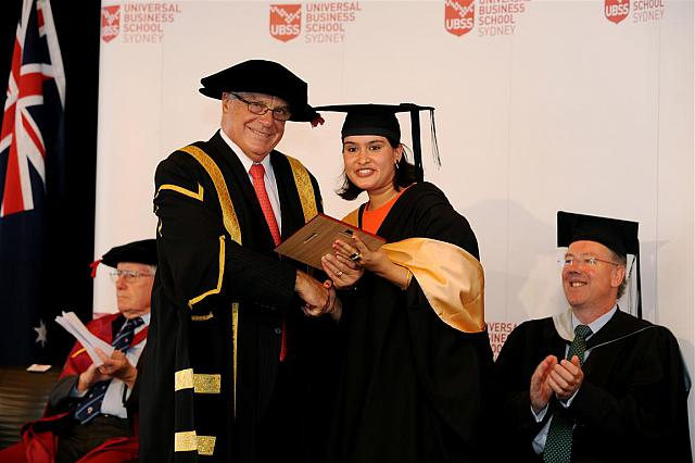 Laxmi Poudel receiving their degree at the April 2014 UBSS Graduation, Opera House, Sydney Australia.