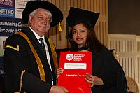 Dipak Chaulagain receiving their degree at the November 2012 UBSS Graduation, Opera House, Sydney Australia.